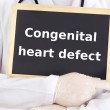 Doctor shows information: congenital heart defect — Stock Photo