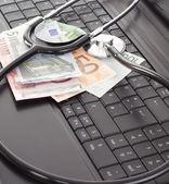 Stethoscope lying on the keyboard — Stock Photo