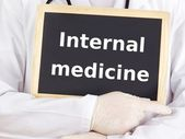 Doctor shows information: internal medicine — Stock Photo