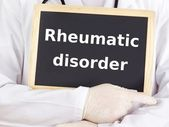 Doctor shows information: rheumatic disorder — Stock Photo