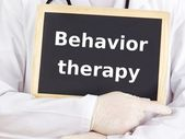 Doctor shows information: behavior therapy — Stock Photo