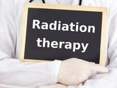 Doctor shows information: radiation therapy — Stock Photo
