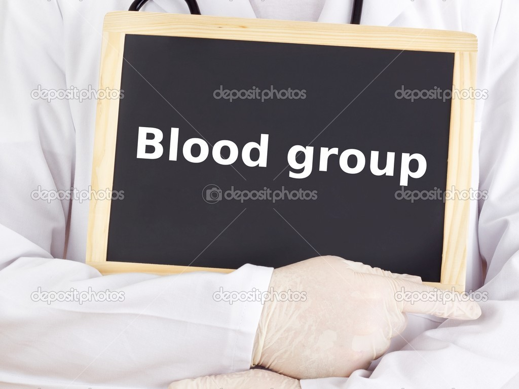 Doctor shows information on blackboard: blood group — Stock Photo #14241701