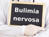 Doctor shows information: bulimia nervosa — Stock Photo