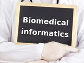 Doctor shows information: biomedical informatics — Stock Photo