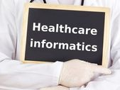 Doctor shows information: healthcare informatics — Stock Photo