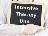 Doctor shows information: intensive therapy unit — Stock Photo