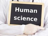 Doctor shows information on blackboard: human science — Stock Photo