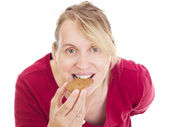 Person eating delicate speculoos — Stock Photo