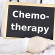 Stock Photo: Doctor shows information: chemotherapy