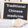 Doctor shows information: traditional chinese medicine — Stock Photo
