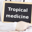 Doctor shows information: tropical medicine — Stock Photo
