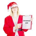 Female santa showing something on clipboard — Stock Photo