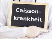 Doctor shows information: caisson disease — Zdjęcie stockowe