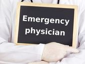 Doctor shows information: emergency physician — Stock Photo