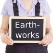 Stock Photo: Craftsperson with blackboard: earthworks