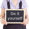 Craftsperson with blackboard: do it yourself — Stock Photo