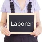 Craftsperson with blackboard: laborer — Stock Photo
