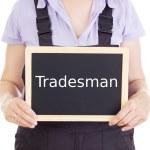 Craftsperson with blackboard: tradesman — Stock Photo