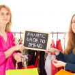 On shopping tour: frantic urge to spend - Stock Photo
