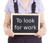 Craftsperson with blackboard: to look for work — Stock Photo