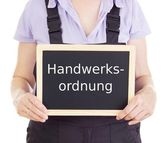 Craftsperson with blackboard: trade and crafts code of germany — Stock Photo