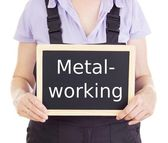 Craftsperson with blackboard: metalworking — Stock Photo