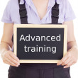 Craftsperson with blackboard: advanced training — Stock Photo