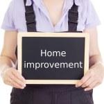 Craftsperson with blackboard: home improvement — Stock Photo #17881935
