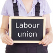 Craftsperson with blackboard: labour union — Stock Photo