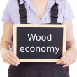 Stock Photo: Craftsperson with blackboard: wood economy