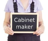 Craftsperson with blackboard: cabinet maker — Stock Photo