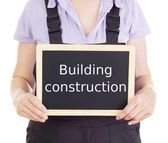 Craftsperson with blackboard: building construction — Stockfoto