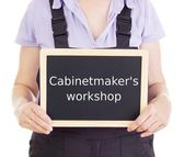 Craftsperson with blackboard: cabinetmaker's workshop — Stock Photo