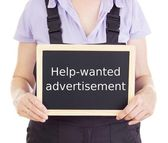Craftsperson with blackboard: help-wanted advertisement — Stock Photo