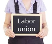 Craftsperson with blackboard: labor union — Stock Photo