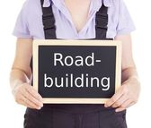 Craftsperson with blackboard: road-building — Stock Photo