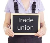 Craftsperson with blackboard: trade union — Stock Photo