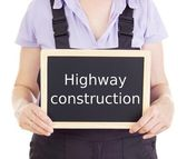 Craftsperson with blackboard: highway construction — Stock Photo