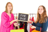 On shopping tour: fire sale — Stock Photo