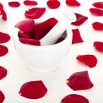Rose petals with mortar — Stock Photo #18799675