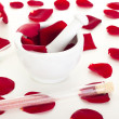 Stock Photo: Rose petals with mortar