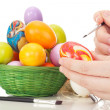 Person painting Easter eggs — Stock Photo