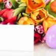 Bunch of tulips with easter egg and card — Stock Photo