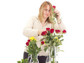 Florist with beautiful roses — Stock Photo