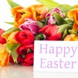 Stock Photo: Bunch of tulips with card: happy easter