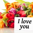 Bunch of tulips with card: I love you — Stock Photo