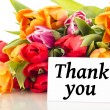 Bunch of tulips with card: Thank you - Stockfoto