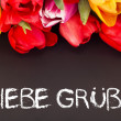 Bunch of tulips with blackboard: kind  regards — Lizenzfreies Foto