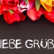 Bunch of tulips with blackboard: kind regards — Zdjęcie stockowe #20184349